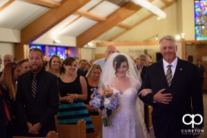 Bride walking down the aisle at Saint Anthony's downtown.