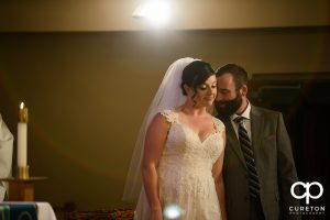 Bride and groom during their Catholic wedding ceremony in Greenville.