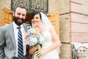 Bride and groom outside the church at Saint Anthony's in downtown Greenville.