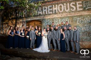 Wedding party on the back deck of the old cigar warehouse before the wedding reception.