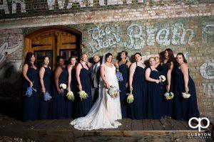 Bride and bridesmaids hitting the bridesmaids movie pose.