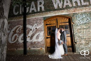 Bride and groom on the back deck of the old cigar warehouse.