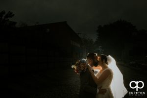 Bride and groom at dusk.