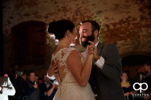 Groom smiling at his bride during the first dance.