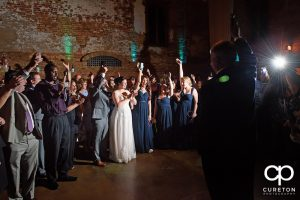 The father of the bride gives a toast at the old cigar warehouse.