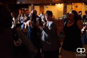 Guests dance at the wedding reception at the old cigar warehouse in downtown Greenville as the party machine djs.