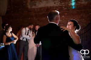 The bride and her father having a dance at her wedding reception.