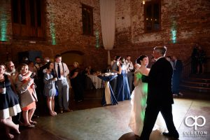The bride and father dance.
