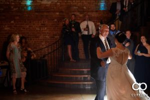 The brides father dancing with his daughter.