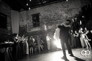The bride and her father hugging on the dance floor at her wedding reception.
