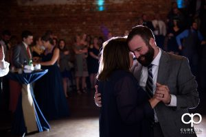 The groom dancing with his mother.
