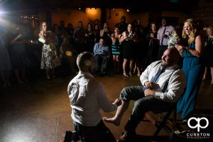 Tricking the guy who caught the garter.