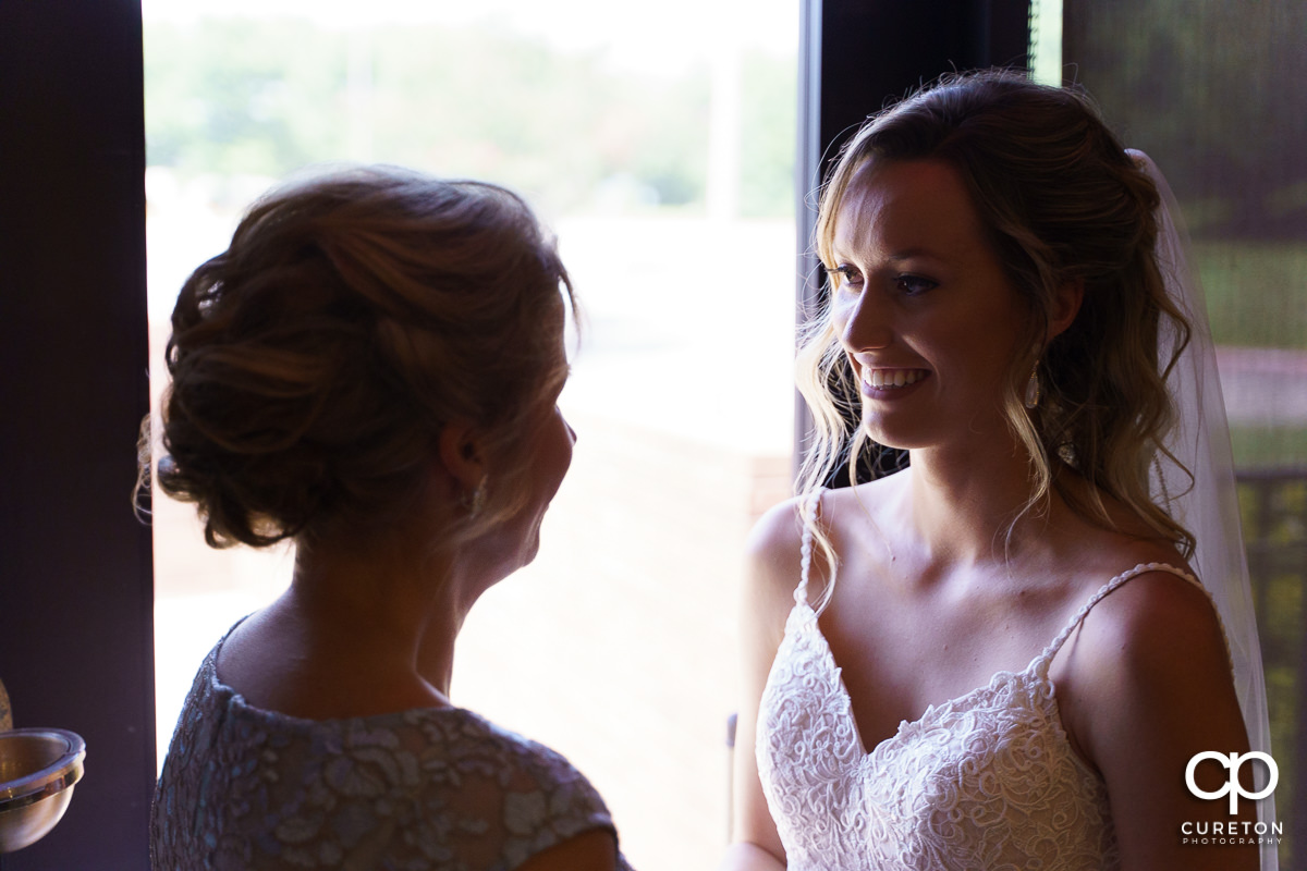 Bride smiling at her mother.