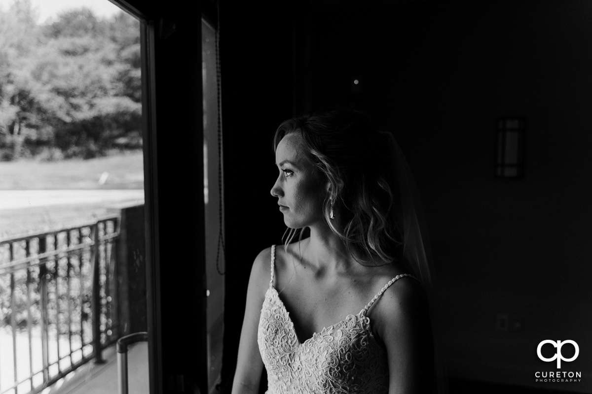 Bride looking out of a window.