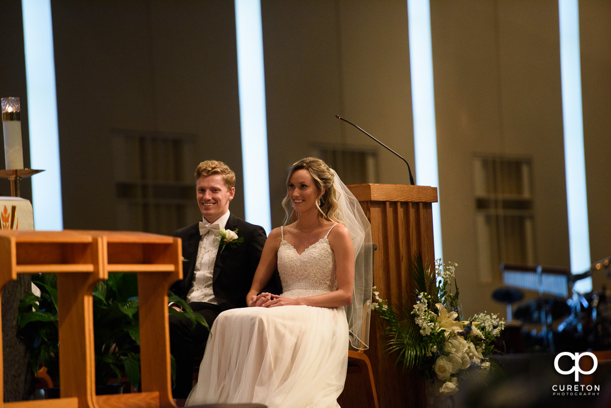 Bride and groom on stage at the church.