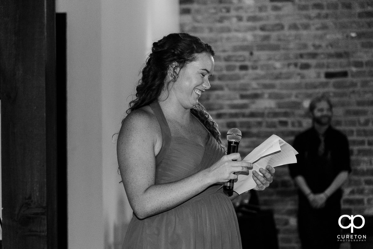 Maid of honor giving a speech at the wedding.