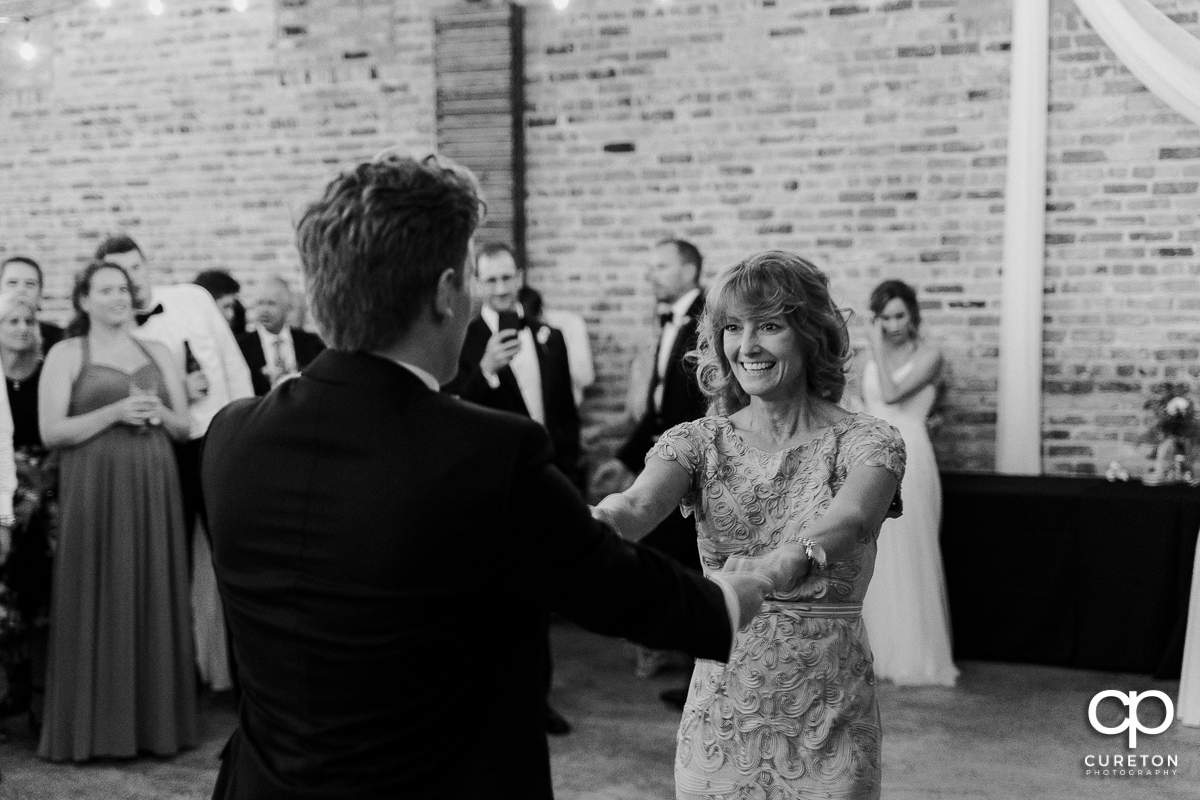 Groom and his mom dancing.