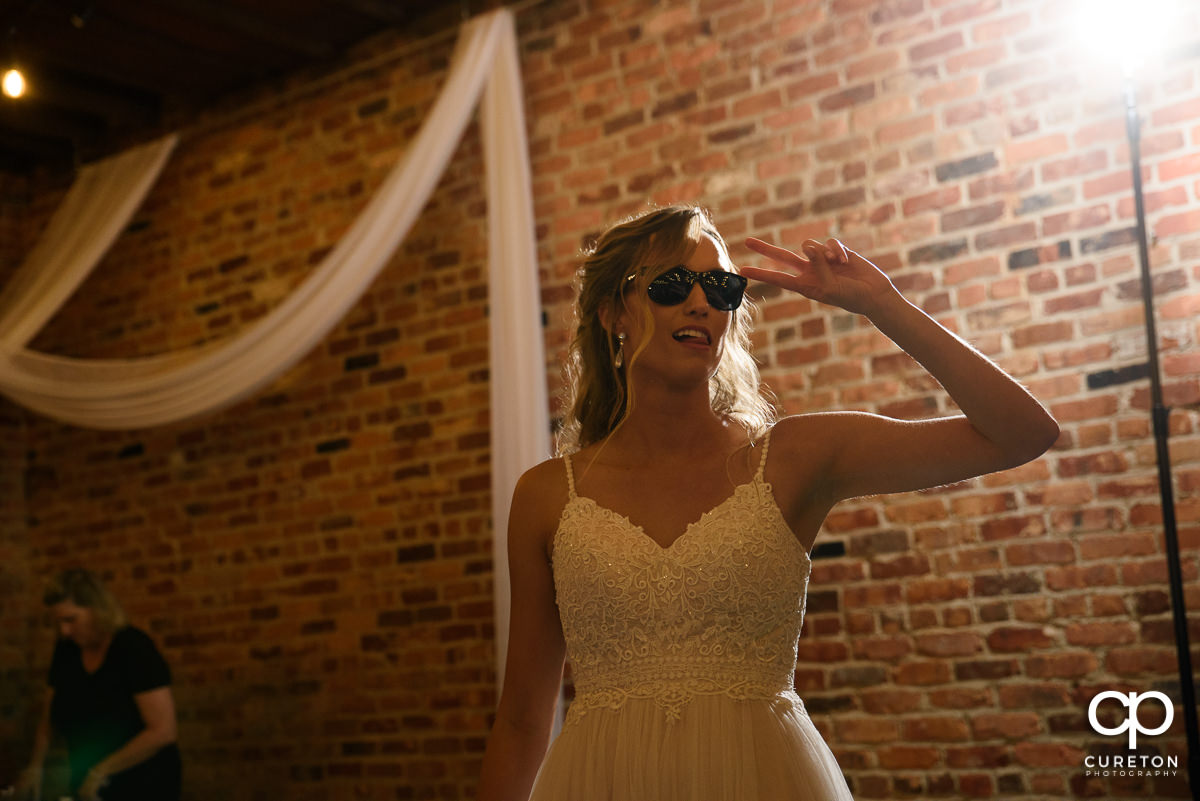 Bride wearing sunglasses.