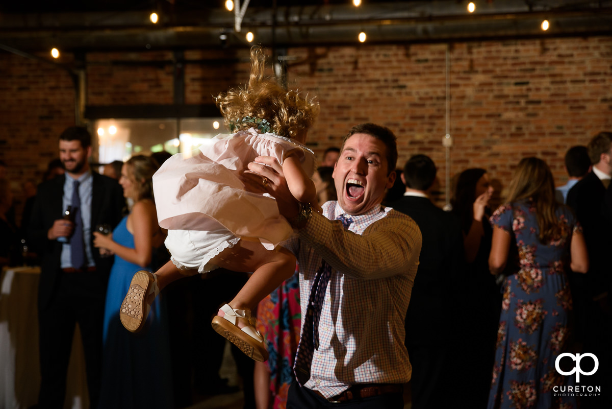 Man and his daughter dancing at the wedding reception.