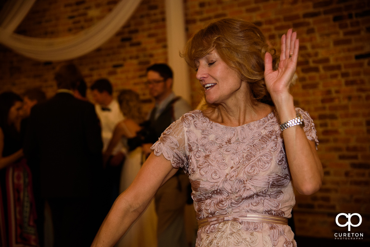 Groom's mom dancing at the wedding reception.