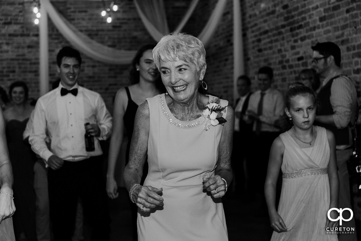 Grandmother dancing at the wedding reception.