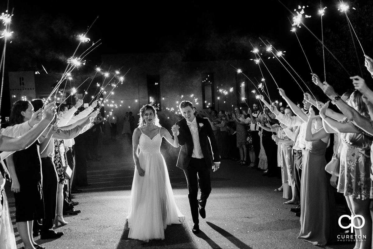 Bride and groom making a sparkler exit from their wedding reception.