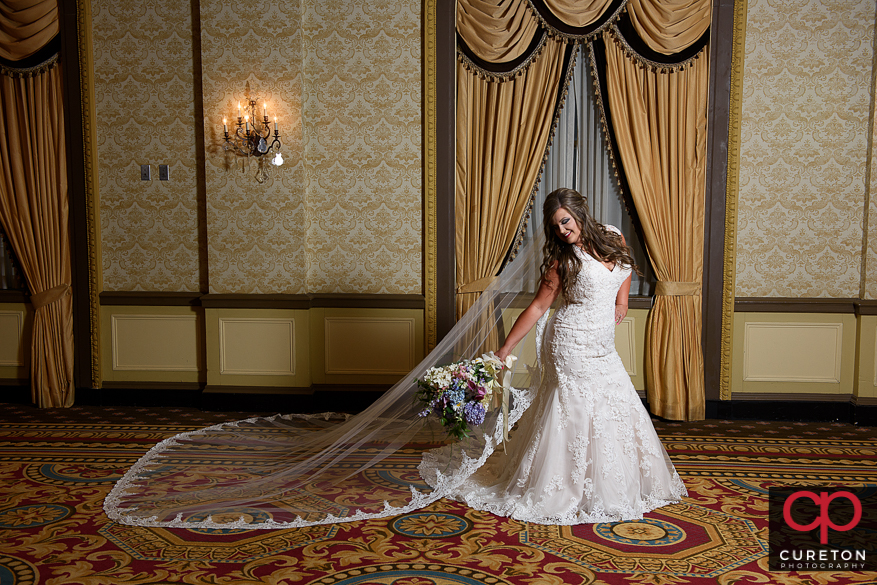 Bride with long veil in the Gold Room of the Westin Poinsett.