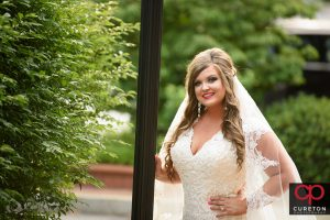 Bride near a lampost in downtown Greenville.