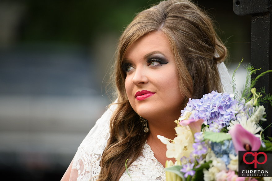Bride with flowers downtown.