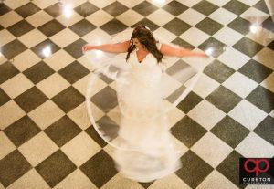 Bride spinning on the tile floors of the Poinsett hotel.