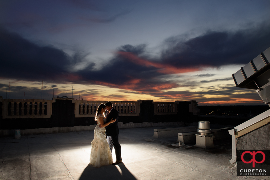 Bride and Groom on the rooftop of the Westin Poinsett at sunset after their wedding in Greenville,SC.