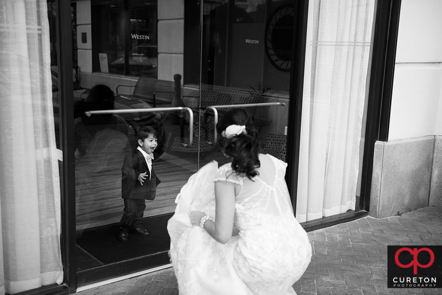 Bride's son sees her in the dress.