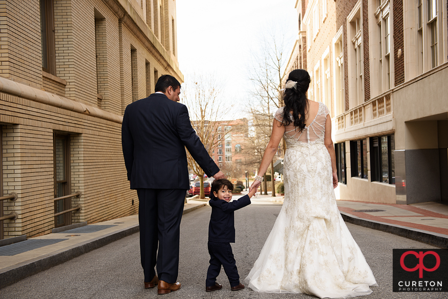 Bride and groom with their young son in downtown Greenville,SC.