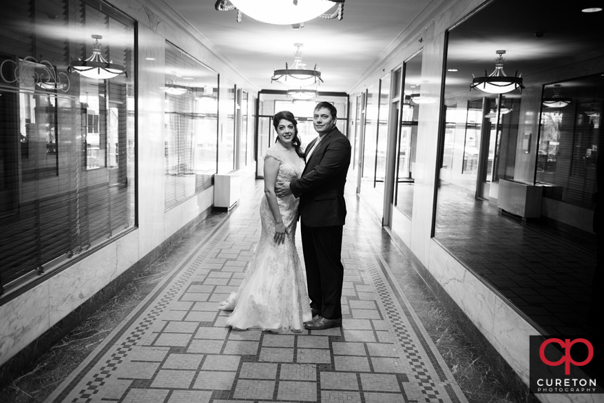 Bride and groom in teh hallway at the hotel.