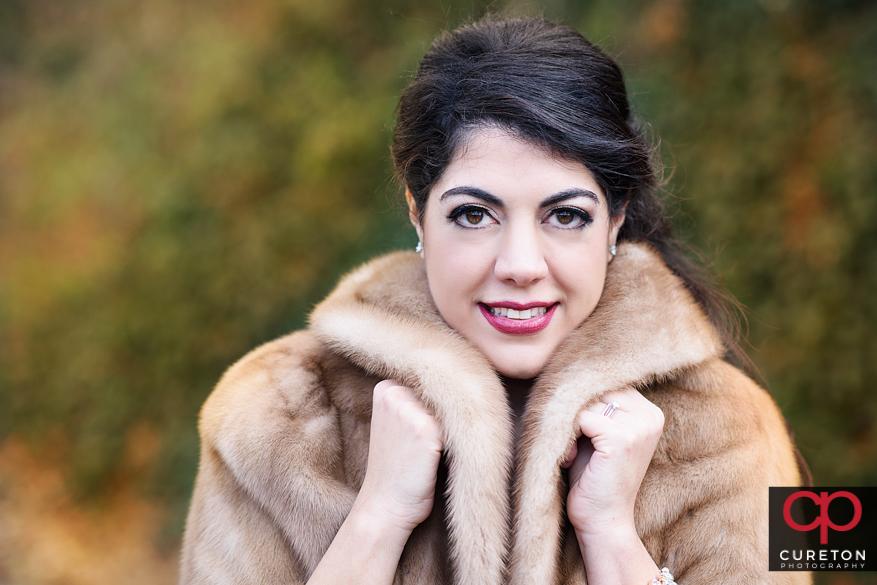 Beautiful bride with a fur coat.