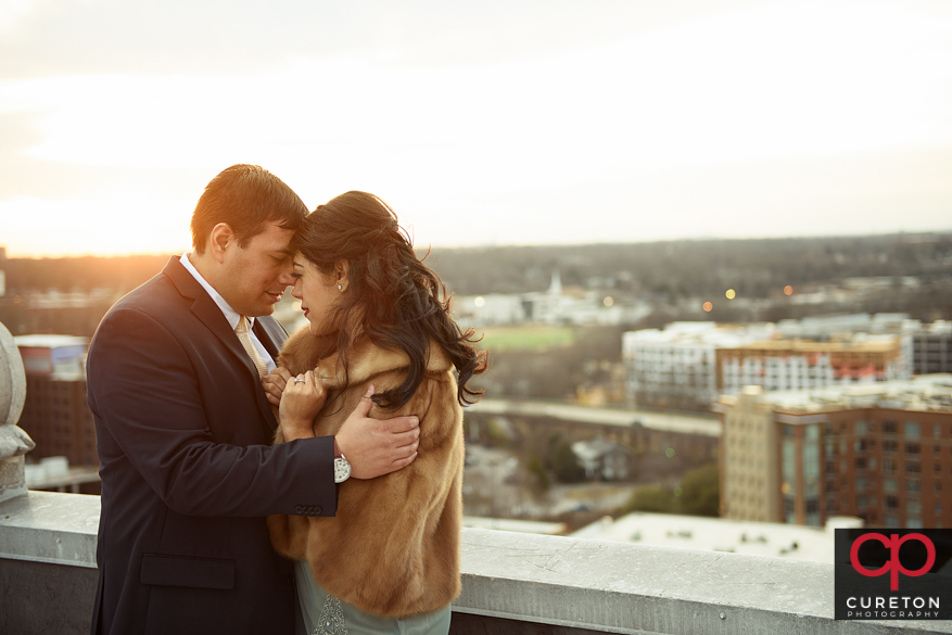 Bride and groom during golden hour on the rooftop.