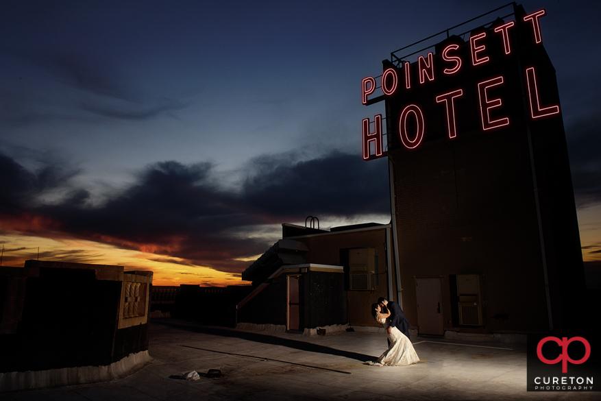 Epic Westin Poinsett rooftop wedding portrait at sunset.