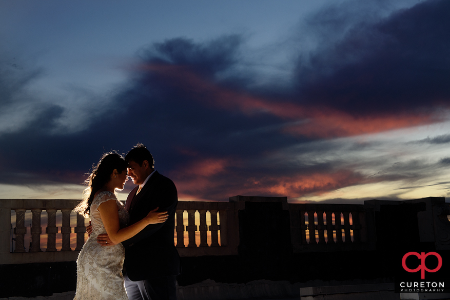 Epic sunset with bride and groom.
