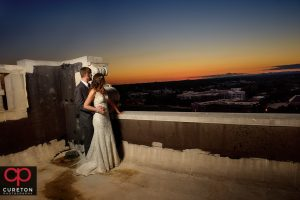 Bride and groom viewing the sunset from the rooftop of the Westin Poinsett during their wedding.