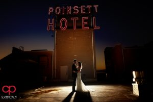 Newlyweds on the rooftop of the Westin Poinsett during their wedding reception.