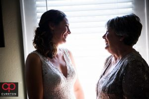 Beautiful bride sharing a moment with her mother before her wedding at St. Mary's in downtown Greenville.