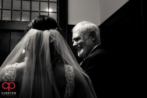 Bride and her father sharing a moment before she walks down the aisle at St. Mary's in downtown Greenville.