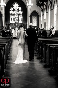 Bride and her father walking down the aisle at St. Mary's Catholic Church in Greenville South Carolina.