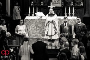 Groom sees bride for the first time as she walks down the aisle at St. Mary's.