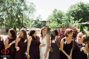 Bridesmaids laughing after the wedding at the playwright in Greenville South Carolina.
