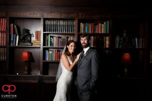 Bride and groom posing in the study.