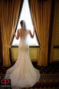 Brides standing in the window at the Westin Westin Poinsett.