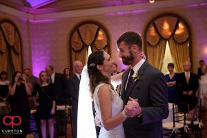 Bride and groom sharing the first dance in the gold room at the Westin.