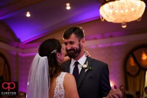 Groom smiling at his bride during their first dance at their Westin Westin Poinsett reception.