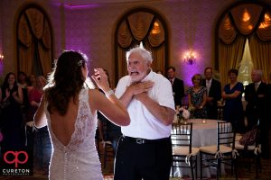 Father dancing with his daughter at the wedding.